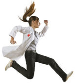 Doctor running over isolated background — Stock Photo