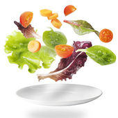 Light salad with floating vegetables — Stockfoto