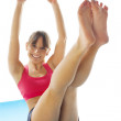 Young fitness woman doing pilates exercise — Stock Photo