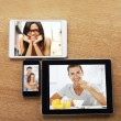 Digital tablets and smart phone with images on a desktop — 图库照片