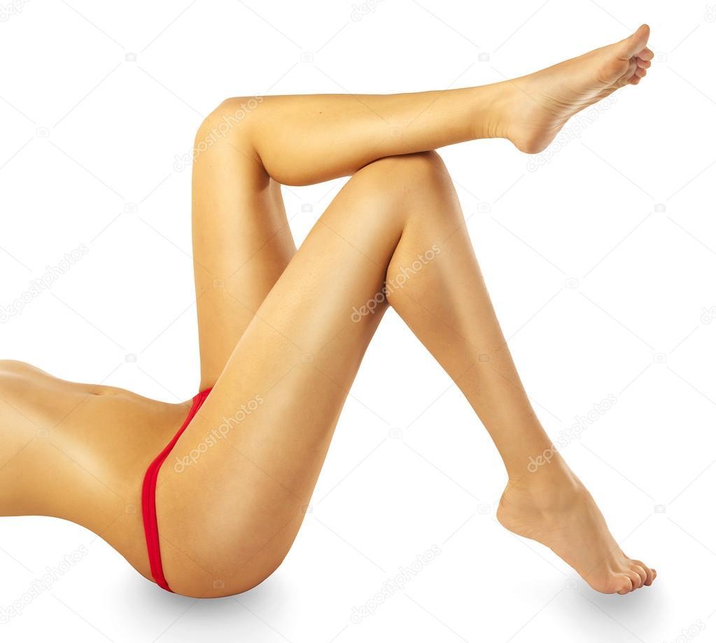 Young woman shaving legs — Stock Photo © belchonock #153725574