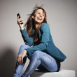 Young business woman smiling with smart phone — Stock Photo