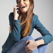 Young business woman smiling with smart phone — Stock Photo #19737579
