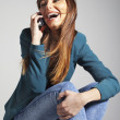 Stock Photo: Young business woman smiling with smart phone