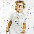 Smiling child with rimmed glasses and confetti — Stock Photo #19922663