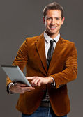 Young businessman showing laptop — Stock Photo