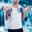 Young man lifting weights on sport gym club — Stock Photo