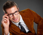 Young interesting businessman with rimmed glasses — Stock Photo