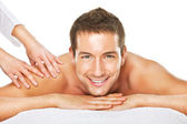 Closeup of a man having a back massage — Stock Photo