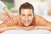Closeup of a man having a back massage — Foto Stock