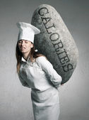 Woman holding a stone with calories concept — Stock Photo