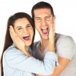 Happy young couple screaming — Stock Photo
