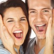 Closeup of happy young couple screaming — Stock Photo