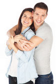 Cheerful young couple standing on white background — Stock Photo