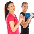 Young man and woman lifting weights. Isolated on white - Stock Photo
