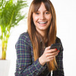 Smiling young woman subject a phone in the office — Stock Photo