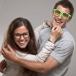 Portrait of a beautiful young happy smiling couple with glasses — Stock Photo #24858447