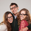 Three smart student friends looking with eyeglasses — Stock Photo