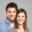 Portrait of a beautiful young happy smiling couple — Stock Photo #26345945