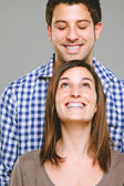 Portrait of a beautiful young couple looking in — Stock Photo
