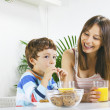 Mother and son having breakfast. — Stock Photo