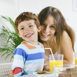 Stock Photo: Mother and son having breakfast.