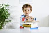Schoolboy studying in home. — Stockfoto