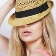Funny blonde woman with straw hat isolated on white — Stock Photo
