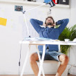 Young creative designer man relaxing at work space. — Stockfoto