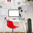 Modern creative workspace with computer and red chair. — Stock Photo
