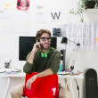 Young creative designer man at phone working at office. — Stok fotoğraf