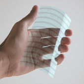Scientific holding one piece transparent of graphene application with binary numbers concept. — Stock Photo