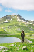 Back view of hiker woman contemplating beautiful Alps landscape. — Stockfoto