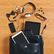 Contents of modern business briefcase on wooden desk. — Stock Photo #31147729