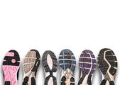 Different shoe sole on a grey background. — Stock Photo