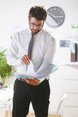 Young businessman looking some papers in office. — Stock Photo