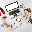 Stock Photo: Overhead of essentials objects in fashion blogger