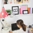 Stock Photo: Fashion womblogger working in creative workspace.