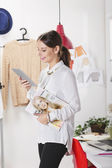 Fashion woman blogger working in a creative workspace with digit — Stockfoto