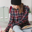 Casual blogger woman doing fashion sketches in her office. — Stock Photo