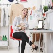 Fashion magazine editor in her office talking with smart phone. — Stock Photo