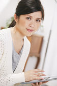 Casual asian woman working with digital tablet at home. — Foto de Stock