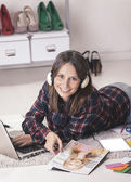 Casual blogger woman working with laptop and magazine in her fashion office. — Stock Photo