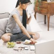 Casual asian woman having breakfast and working in home. — Stock Photo