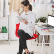 Fashion woman blogger working in a creative workspace with digit — Stock Photo