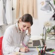 Stock Photo: Fashion woman blogger working in a creative workspace.