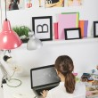 Fashion woman blogger working in a creative workspace. — Stock Photo