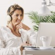 Mature businesswoman working with laptop at home. — Stock Photo #37641923