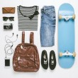 Stock Photo: Overhead of essentials skater woman.