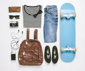 Overhead of essentials skater woman. — Stock Photo